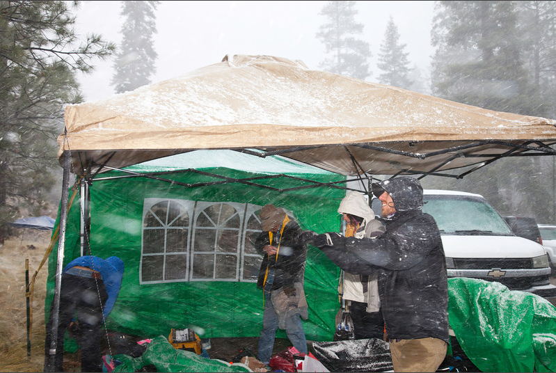 [Photo by Megan Galope] Runners, spectators, volunteers and tents alike got a proper trashing in the blizzard.